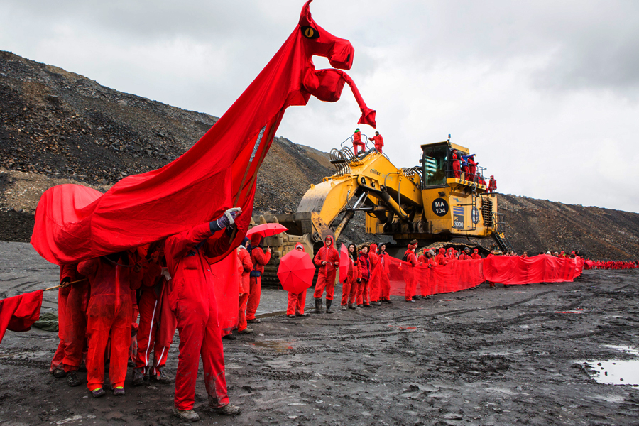 Activists from Reclaim The Power's End Coal Now camp occupy and halt work in the UK's largest open cast coal mine, Friss Y Fran.